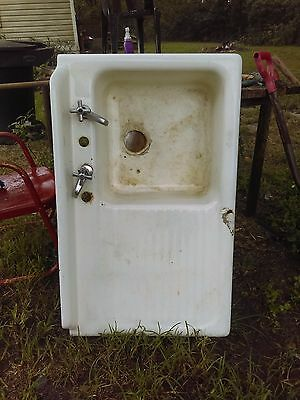 Vintage Porcelain Coated Cast Iron Sink. 6 IInch depth.  In good condition.