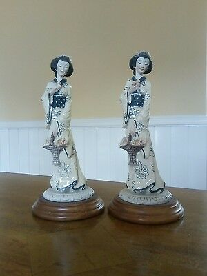A pair of matching Oriental China figurines