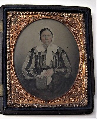 ca. 1858 AMBROTYPE photograph of Amish woman holding BIBLE or daguerreotype case