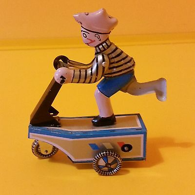 Vintage tine toy wind up boy on scooter, c1970 collectable