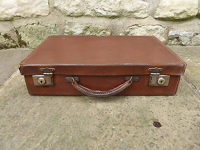 Small Vintage Leather Suitcase with Clasps and Lock.