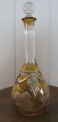 "Exquisite Victorian amber glass decanter, deeply cut.  Air bubble stopper.10""."