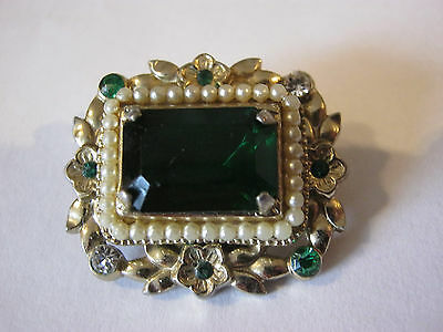 Vintage Coro signed emerald green goldtone brooch, surrounded by flowers