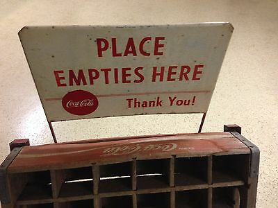"Antique Metal Coca-Cola Bottle Return Rack with ""Place Empties Here"" sign"