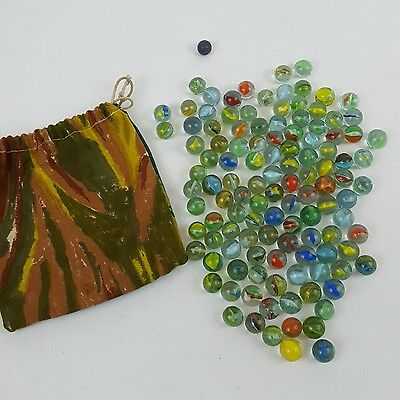 Collection of 117 vintage 1970's cats eye glass marbles with carry bag