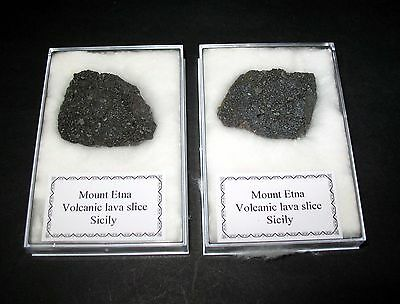 Mount Etna volcano lava bomb slice in display case from 2011 volcanic eruption