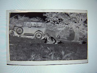 Vintage Negative Car on Roadside Wheel on Side Person Laying in Grass