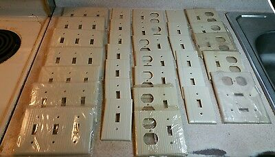 Large lot of vintage leviton ribbed bakelite wall plate covers N.O.S.