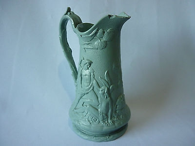 Antique highly decorative jug with figural foliate relief decoration - unmarked