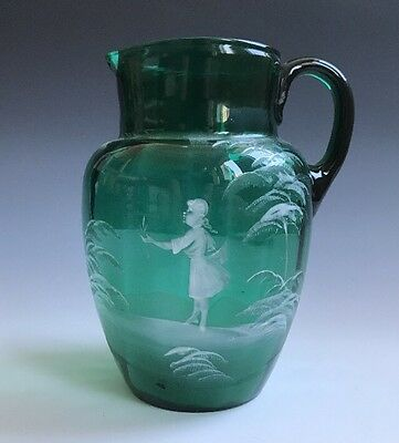 A Fine Antique Mary Gregory Decorated Green Glass Pitcher