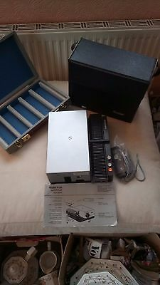 Rollei slide projector with case. Auto Changer. Slide storage box. Instructions