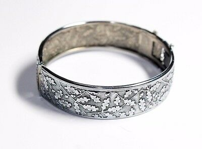 Vintage Silver Coloured Acorn Patterned Hinged Bangle with safety chain (c1970s)