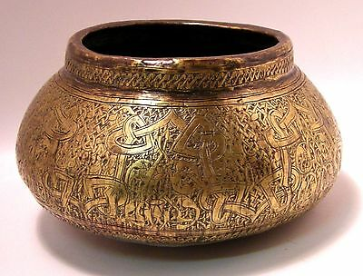 Fars brass basin, Western Persia, 14th cent with Arabic calligraphy 17 cm dia.