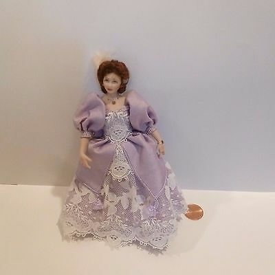 Beautiful Miniature Lady Doll Wearing A Fabulous Purple Dress