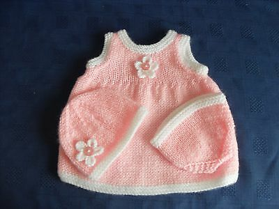 Set of hand knitted  dolls clothes to fit 14 inch doll in pink and white