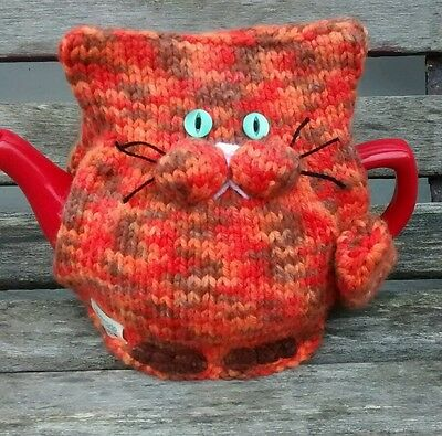 Hand-knitted Marmaduke the ginger cat tea cosy. Large size