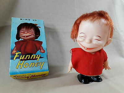 VINTAGE RED FUNNY HONEY WIND UP DANCING GIRL DOLL MADE in Japan Item No.4436