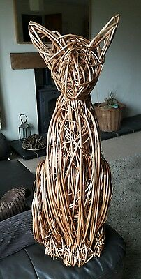 willow sculpture of a siamese  cat