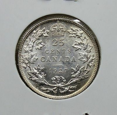 Images of Not Real Canadian and NFLD Coins including markers and new 1927 25 cnt
