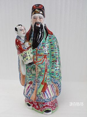 Oriental Japanese Wise Man with Child, Impressed mark to base.
