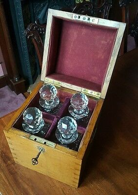 victorian oak decanter box with 4 cut glass decanters.