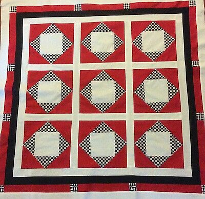 Handmade red and black lap quilt