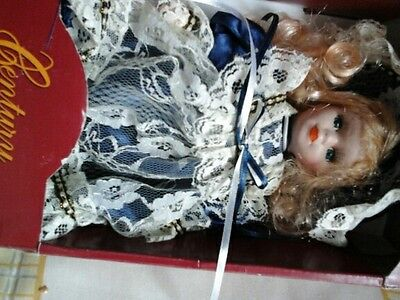 Genuine porcelain doll Hand crafted colletable