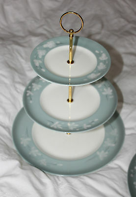 Big floral cake stands with solid golden fittings