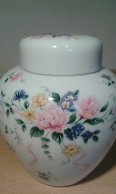 Very Pretty White, with Floral design, ceramic Ginger Jar.