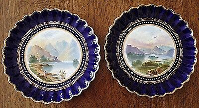 A Victorian pair of landscape decorated porcelain cabinet plates by Spode