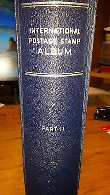 Scott International Album II with some stamps. Pages & Binder Excellent
