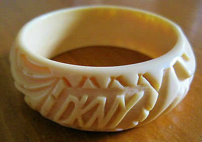 """DKNY  Bangle Bracelet """"carved or molded"""" Yellowish~Neutral Plastic"""