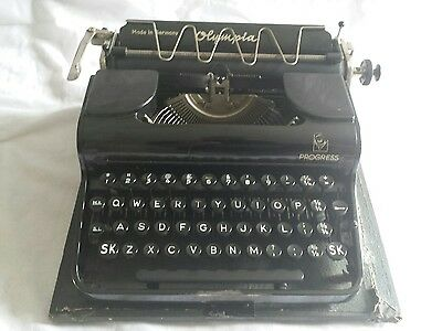 Vintage 1940s Olympia progress portable typewriter with carry case