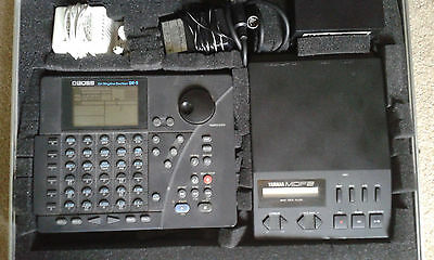 Boss DR5 Drum Machine, Yamaha MDF-2 Data Filer, and carrying case