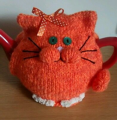 Hand-knitted Jemima the ginger cat tea cosy.