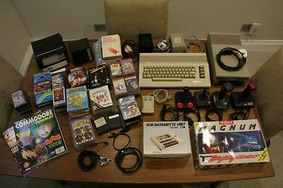 Commodore 64 vintage computer with lots of accessories