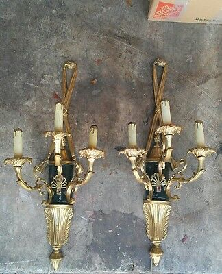 vintage pair of french empire bronze sconces.