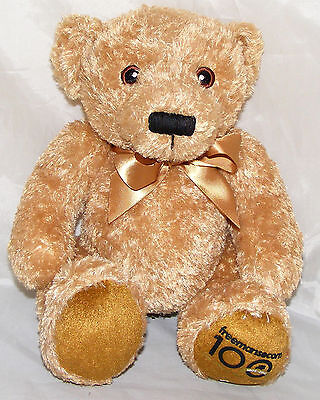 Teddy Bear with Brown Eyes and a Brown Bow - Soft Toy