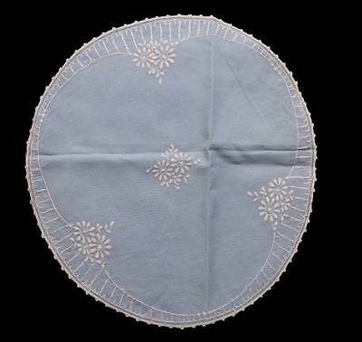 Vintage embroidered blue and white round large doily measuring 38cm long.