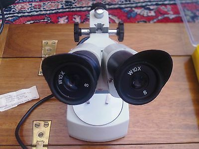 Motic binocular microscope with integrated lamp and accessories