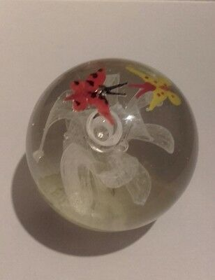 vintage glass paperweight with flower and butterflies
