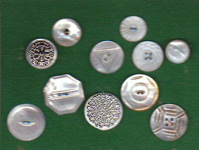 11 fancy pearl buttons mounted on card