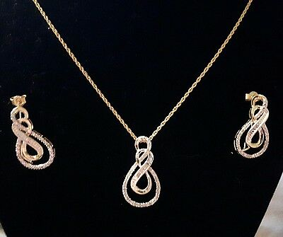 Diamond earrings and pendant set