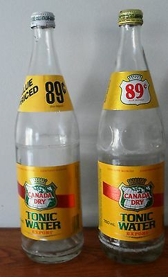 2- different vintage Canada Dry Tonic Water 750 ml bottles with foil labels
