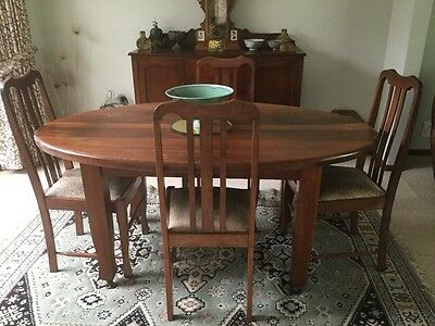 Antique oval dining table and chairs