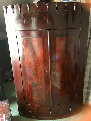 Antique bow fronted mahogany corner cupboard