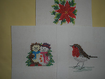 Three Completed Cross Stitch Christmas Pieces.
