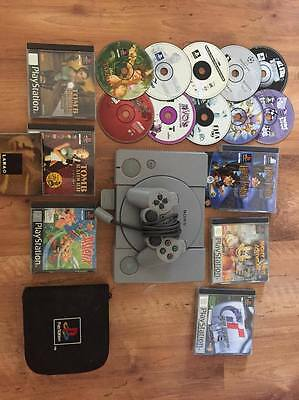 Lot PS1 + 16 jeux + sacoche PlayStation