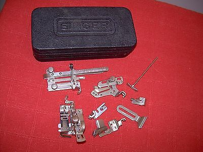 Vintage Singer sewing machine accessories and box.