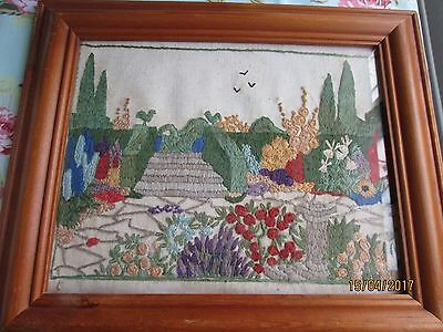 Vintage embroidered picture of a stately home garden